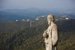 Statue over the city Stock Photos