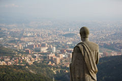 Statue over the city royalty free stock image