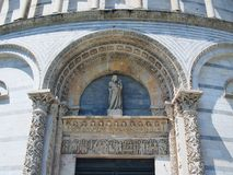 Statue Over Entrance to Pisa Bapistery Royalty Free Stock Photo