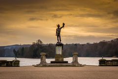Statue over the lake Royalty Free Stock Image