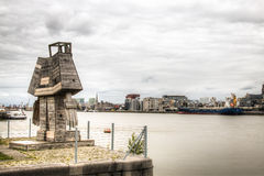 Statue overlooking the Antwerp skyline with the schelde river Royalty Free Stock Photo