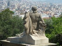 Statue overlooking Barcelona from the hillside. A statue overlooking Barcelona through the trees on the hillside by the Museum Stock Photo