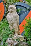 Statue of owl carved from white stone close up stock photography