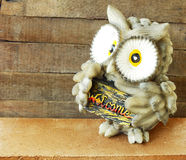 Statue of owl  on wooden background still life Stock Photography