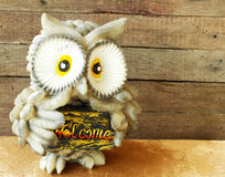 Statue of owl on wooden background still life Royalty Free Stock Photo
