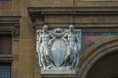 Statue 006. Pair of white statues at side of historic archway entrance Stock Photo