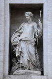 Statue on the Palazzo Poli Royalty Free Stock Images