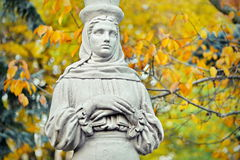 Caryatid. Statue in the Herastrau Park, on autumn background - landmark attraction in Bucharest, Romania. Caryatid. Statue on autumn background, in the Herastrau Royalty Free Stock Photo