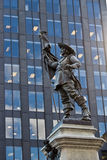 Statue of Paul de Chomedey with modern building background Royalty Free Stock Photos