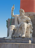 Statue at pedestal of Rostral Column in Saint Pete. Rostral columns are an integral part of the ensemble of the Spit of Basil Island in Saint Petersburg.. They Stock Photography