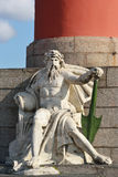 Statue at pedestal of Rostral Column in St.Petersburg Royalty Free Stock Photos