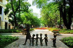 The Statue & pedestrian avenues in Shamian. Shamian Island is a sandbank island in the Liwan District of Guangzhou city, Guangdong province, China. There are Stock Photo