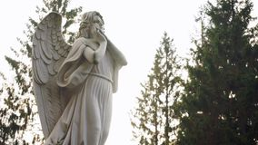 Statue of a pensive angel. Static camera stock video