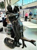 Statue of people hugging in scotland airport Royalty Free Stock Images