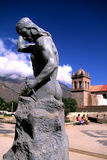 Statue- Peru. Statue & colonial church in the Incan town of Calca (Sacred Valley), Peru Stock Photography