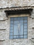 Statue in Peruggia. Christ window bizard ancient religion 2017 italy italia travelling holiday Royalty Free Stock Images