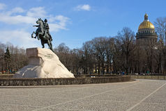 Statue of Peter the Great and Saint in Saint Petersburg. Statue of Peter the Great and Saint Isaac`s Cathedral in Saint Petersburg. Man on the horse Royalty Free Stock Photography