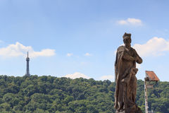 Statue and Petrin Lookout Tower in Prague Royalty Free Stock Photography