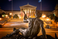 Statue with Philadelphia Museum of Art royalty free stock photography