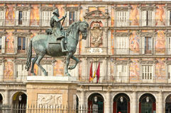 Statue of Philip III with bakery house on bakcground Stock Images