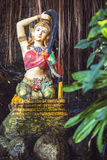 Statue of Phra mae thorani twisting her hair , the buddhist godd Royalty Free Stock Photography
