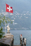 Statue Pier with Swiss Flag Stock Photography