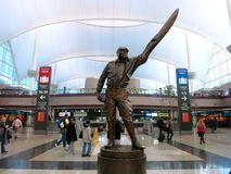 Statue of a Pilot in Denver International Airport Lobby. A sculpture of a pilot holding up an airplane propeller in the lobby of the Denver International Airport Stock Photos
