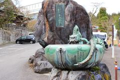 Statue Pipe with water dippers at Rinnoji Stock Photos
