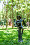 Statue of Piper in Garden Stock Photo