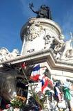 The statue of Place de la Republique is turned to a memorial site Stock Photos