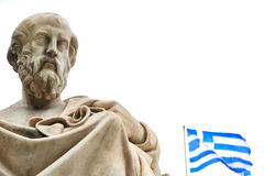 Statue of Plato in Athens. Statue of ancient Greek philosopher Plato and the greek flag, in Athens Stock Photo