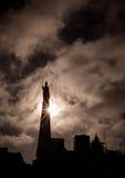 Statue at Plaza de Mayo. Dark cloudy skies behind a statue at Plaza Mayo Royalty Free Stock Images