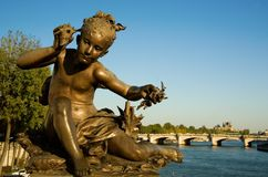 Statue on the Pont Alexandre III, Paris Stock Image