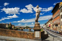 Statue on the Ponte Santa Trinita. Statue of Summer by Giovanni Caccini at Ponte Santa Trinita Holy Trinity Bridge, the oldest elliptic arch bridge in the world Royalty Free Stock Photos