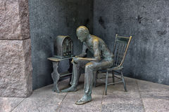 Statue of poor man listening to radio Royalty Free Stock Image