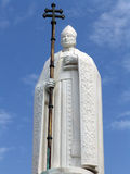 Statue of a Pope. With blue sky on background Stock Photo