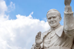 Statue of pope John Paul II blessing people, with cloudy sky in Royalty Free Stock Photography