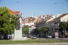 Statue of Pope John Paul II in Coimbra and the city view stock photography