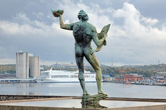 Statue of Poseidon on background of ferry terminal in Stockholm Royalty Free Stock Image