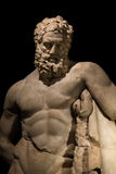 A statue of powerful Hercules, closeup, isolated in black Royalty Free Stock Photo