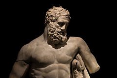 A statue of powerful Hercules, closeup, isolated in black Stock Photo