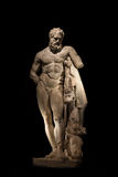 A statue of powerful Hercules, closeup, isolated in black Stock Photography