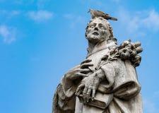 Statue in Praga with bird royalty free stock photo