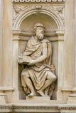 Statue at Prague Loreta. Statue at the Santa Casa of Loreta, a large pilgrimage site in Hradcany, Prague, of a figure holding a Sacred Text Royalty Free Stock Image