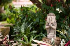 Statue of prayer. In tropical garden Royalty Free Stock Photos