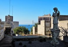 Statue of a praying angel. Long shot of a praying angel on the cemetery in Valparaiso with the sea in the background stock image