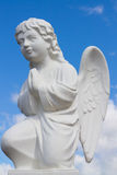 Statue of a praying angel. Tranquil Scene of statue of  angel child at the blurred background Royalty Free Stock Image