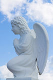 Statue of a praying angel. Tranquil Scene of statue of  angel child at the blurred background Stock Photography