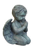 Statue of a praying cherub isolated. Statuette of a kneeling cherub angel praying.  Isolated on white Stock Image
