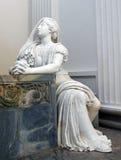 Statue of a Praying Lady inside a Danish Church. Statue of a Praying Lady Makes Her Pray to God Royalty Free Stock Image